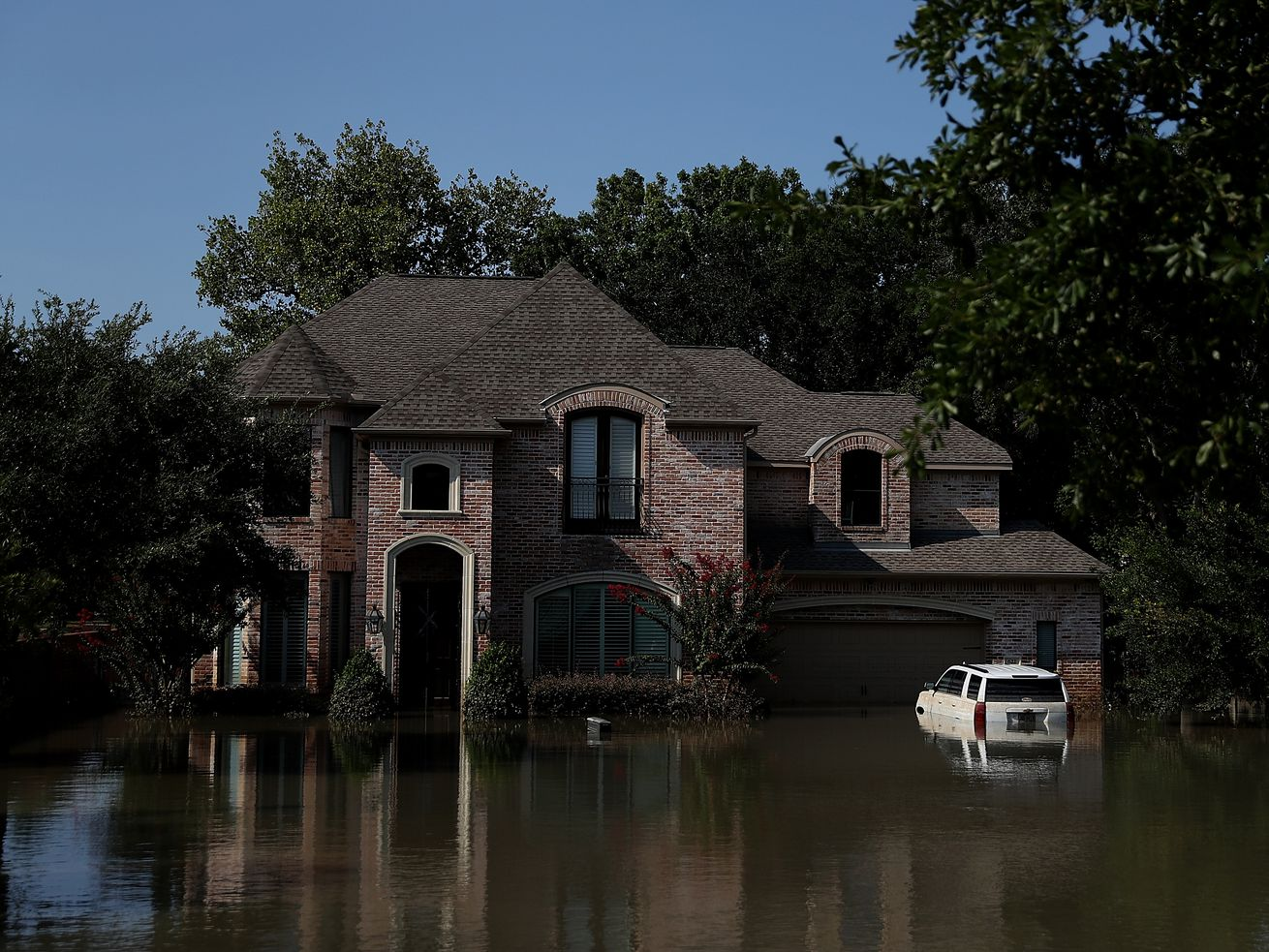 Floodwaters surround a home on September 6, 2017 in Houston, over a week after Hurricane Harvey hit Southern Texas.