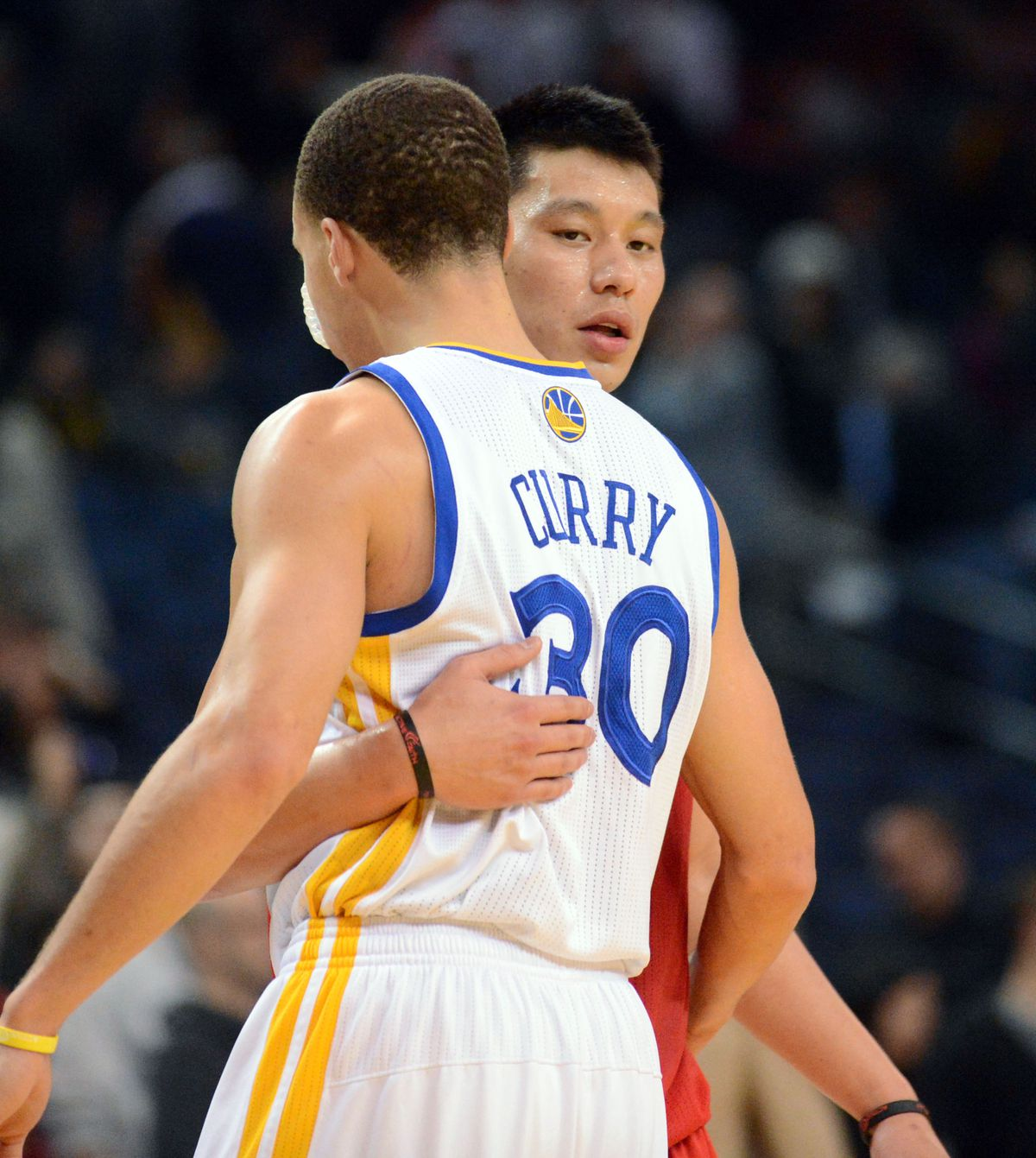 Golden State Warriors' Stephen Curry (30) left, and Houston Rockets' Jeremy Lin (7) hug after their basketball game held at Oracle Arena in Oakland, Calif., on Tuesday, Feb. 12, 2013. The Houston Rockets went on to win the game 116 to 107. (Doug Duran/Sta