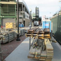 Gate D, through the chainlink, new supplies ready and waiting -
