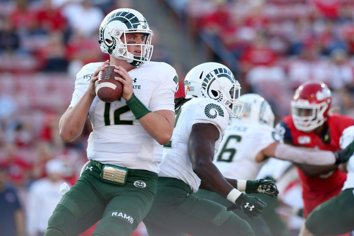 Colorado State Rams quarterback Patrick O'Brien (12) looks to throw a pass against the Fresno State Bulldogs in the first quarter at Bulldog Stadium.