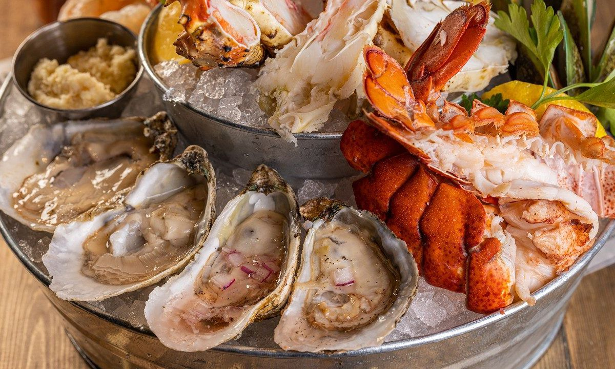 Oysters and lobster tail on ice