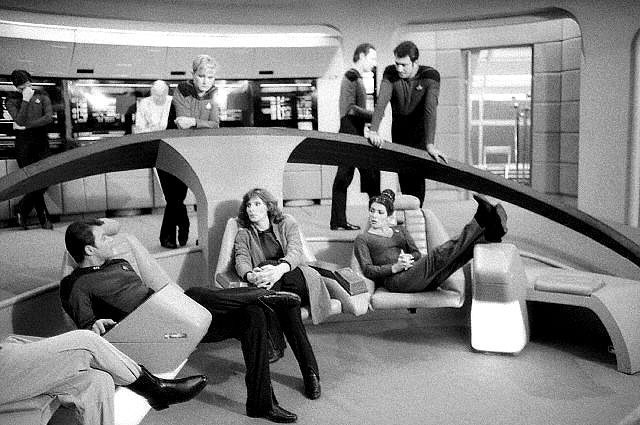 The cast of Star Trek: The Next Generation hanging out on the set of the bridge.