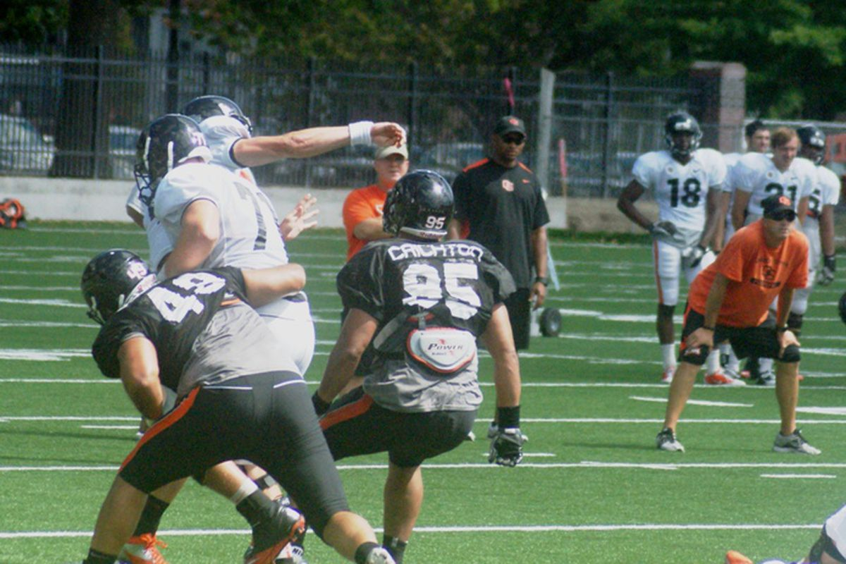 Sean Mannion releases a pass under pressure in Oregon St.'s final pre-season scrimmage. <em>(Photo by Andy Wooldridge)</em>