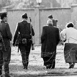 An East German couple is turned away from the border, blocked by East German soldiers and barbed wire, after trying to cross into West Berlin, Aug. 13, 1961. To stem the flow of refugees to the West, East Germany closed the border to all citizens and residents, except those with a special police permit.