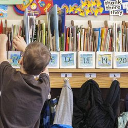 A second-grade student selects a book off the shelf at Daybreak Elementary School on Monday, Feb. 25, 2013. HB318, sponsored by Rep. Becky Edwards, R-North Salt Lake, would set class-size caps at 20 students for kindergarten, 22 for first and second grades, and 24 for the third grade.