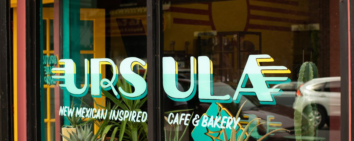 The exterior of a restaurant with the words ursula written on the front