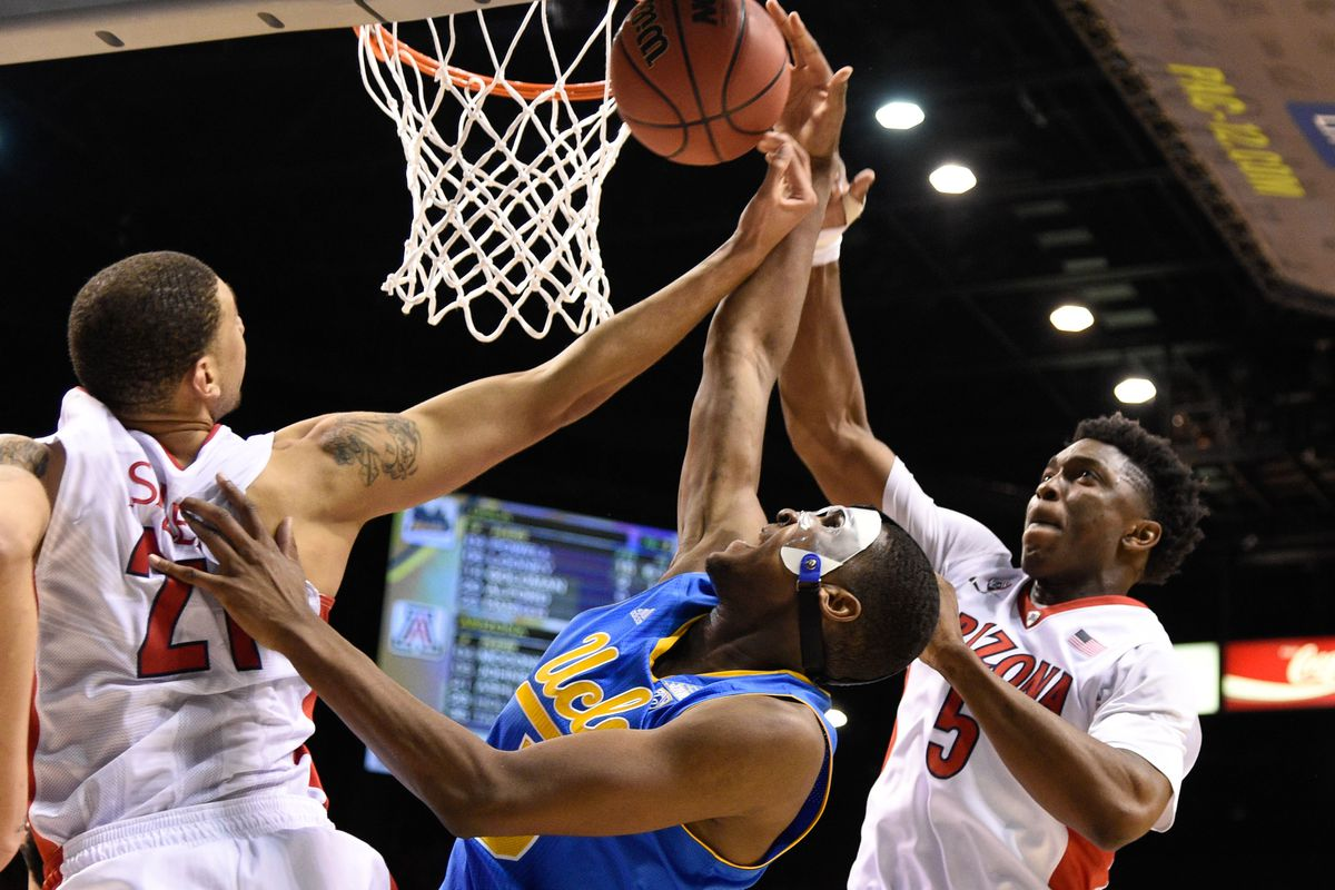 In an apparent preview of the Bruins' NCAA opener, Kevon Looney dons the mask and battles the Cats