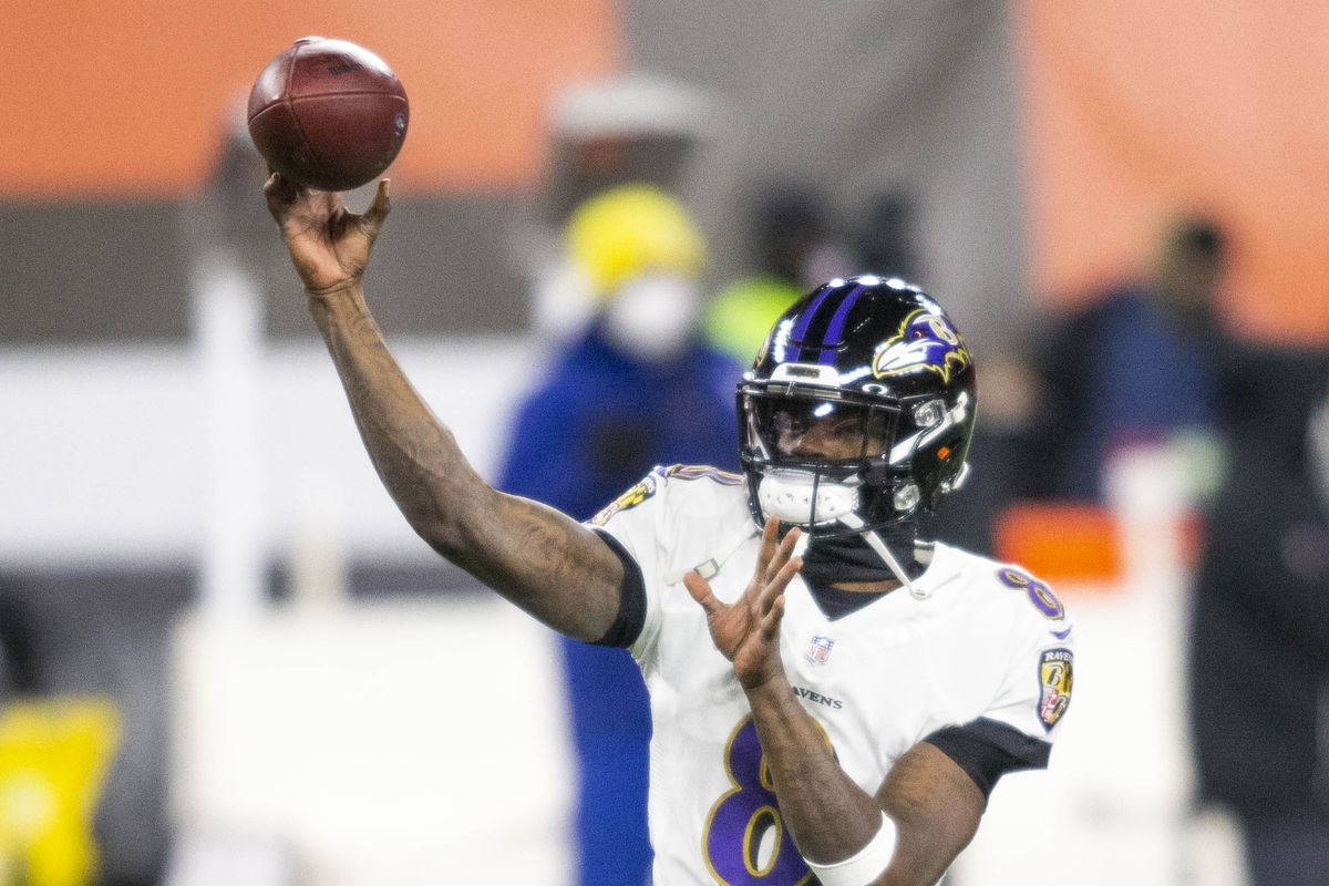 Baltimore Ravens quarterback Lamar Jackson (8) throws the ball during warmups before the game against the Cleveland Browns at FirstEnergy Stadium.