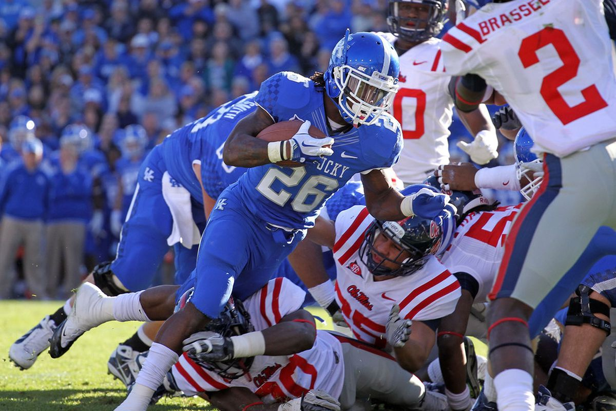 LEXINGTON, KY - NOVEMBER 05:  CoShik Williams #26 of the Kentucky Wildcats runs for a touchdown during the game against the  Mississippi Rebels at Commonwealth Stadium on November 5, 2011 in Lexington, Kentucky.  (Photo by Andy Lyons/Getty Images)