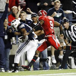 Brigham Young Cougars wide receiver Ross Apo (11) gathers in a pass for a touchdown in front of Utah Utes defensive back Conroy Black (9)during play as BYU and Utah play Saturday, Sept. 17, 2011