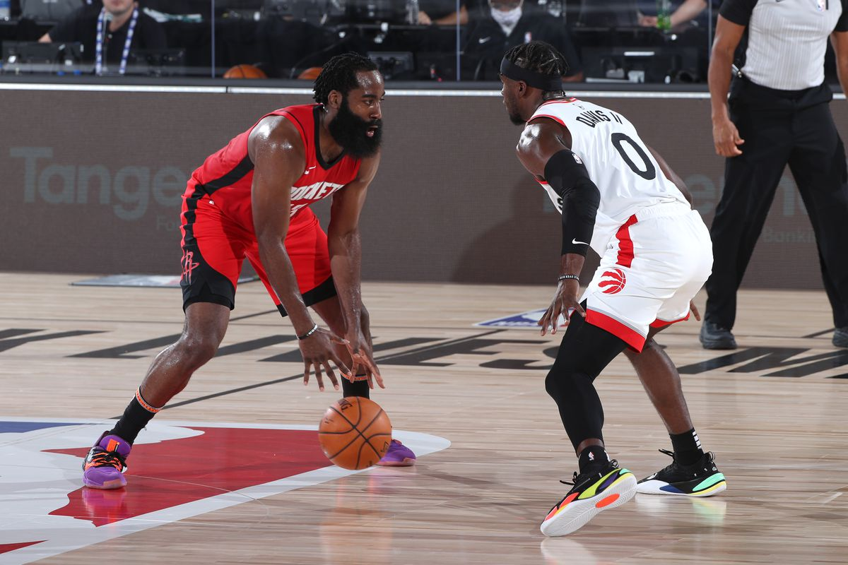 James Harden of the Houston Rockets handles the ball against the Toronto Raptors on July 24, 2020 at The Arena at ESPN Wide World of Sports Complex in Orlando, Florida.