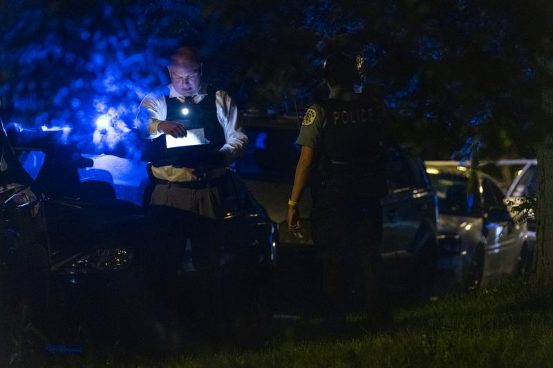 Chicago police work the scene where 27-year-old man was shot and killed in the 5600 block of S Marshfield Ave, in the West Englewood neighborhood, Friday, June 4, 2021.