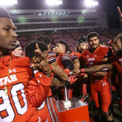 Utah Utes players celebrate their win over the Colorado Buffaloes at Rice-Eccles Stadium in Salt Lake City on Saturday, Nov. 25, 2017.