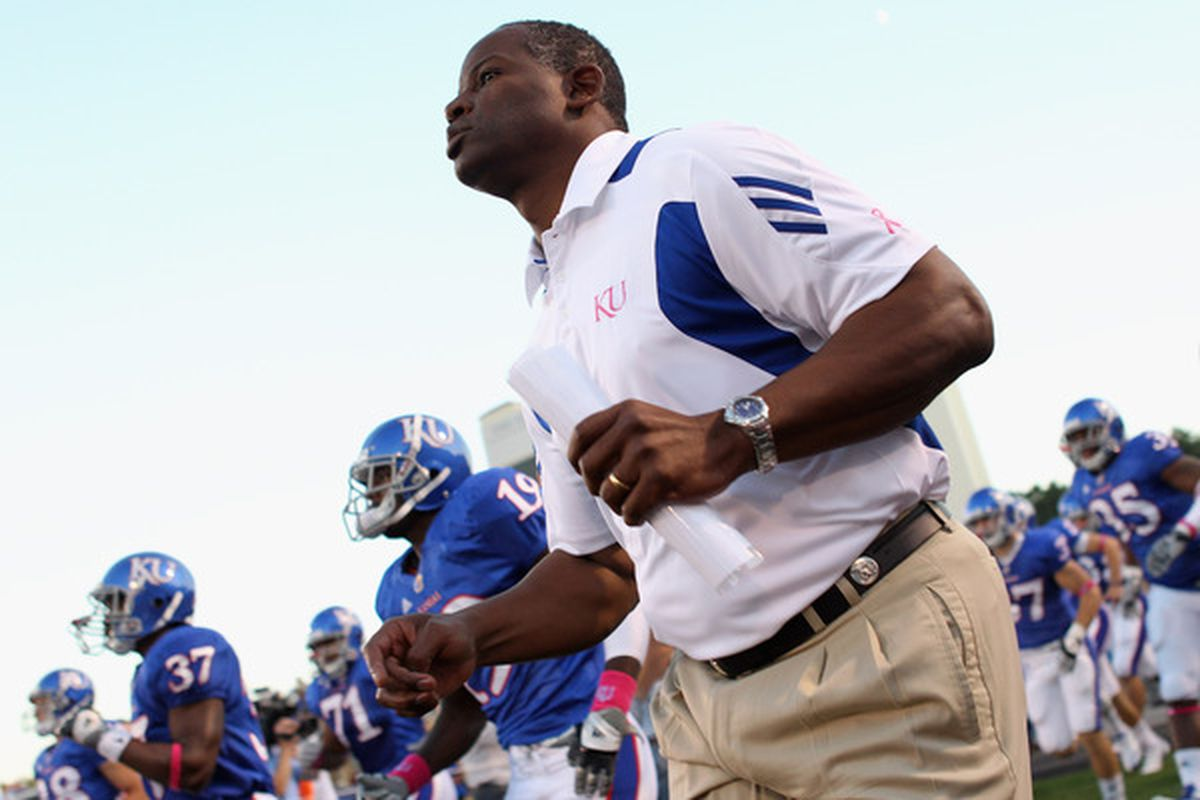 LAWRENCE KS - OCTOBER 14:  Head coach Turner Gill of the Kansas Jayhawks trots onto the field ahead of the game against the Kansas State Wildcats on October 14 2010 at Memorial Stadium in Lawrence Kansas.  (Photo by Jamie Squire/Getty Images)