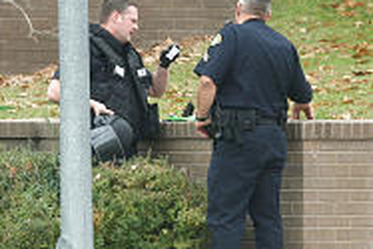 Provo police look over what turned out to be a geocache \— placed so that it could be found via GPS.