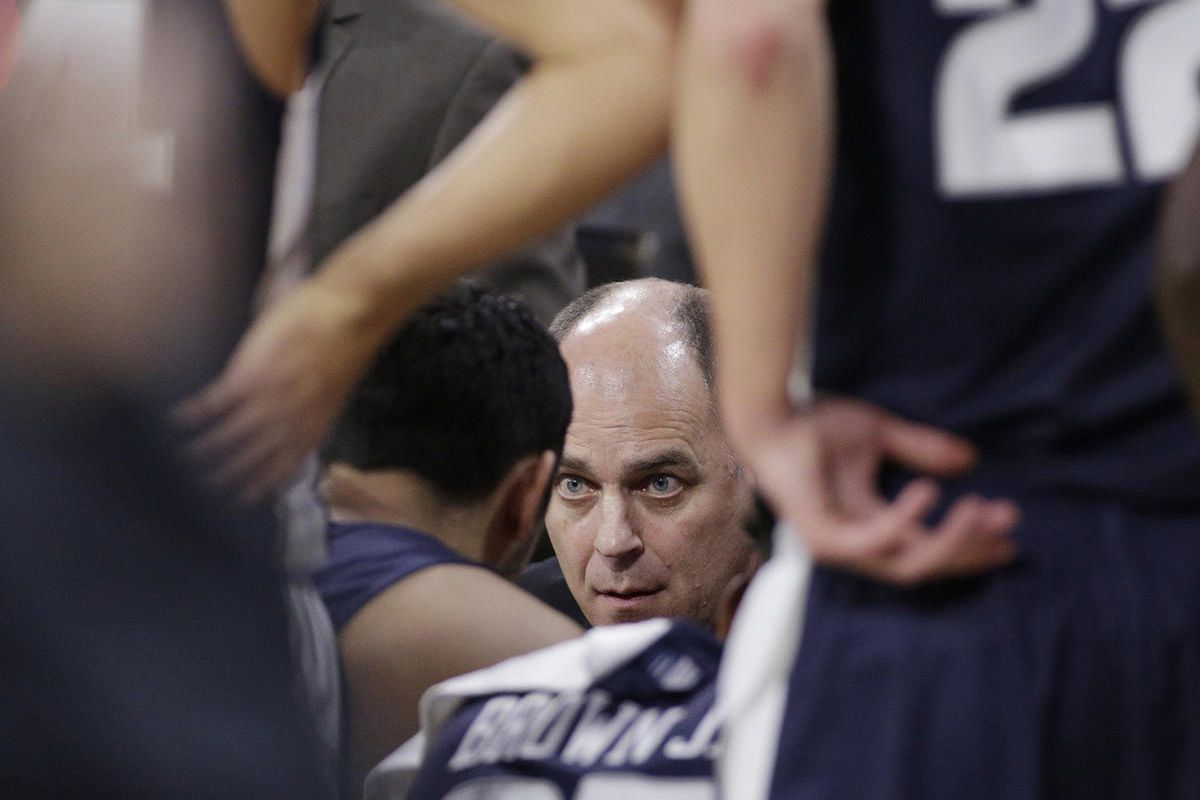 Utah State coach Tim Duryea, center, speaks with his players during a timeout in the first half of an NCAA college basketball game against Gonzaga in Spokane, Wash., Saturday, Nov. 18, 2017. (AP Photo/Young Kwak)
