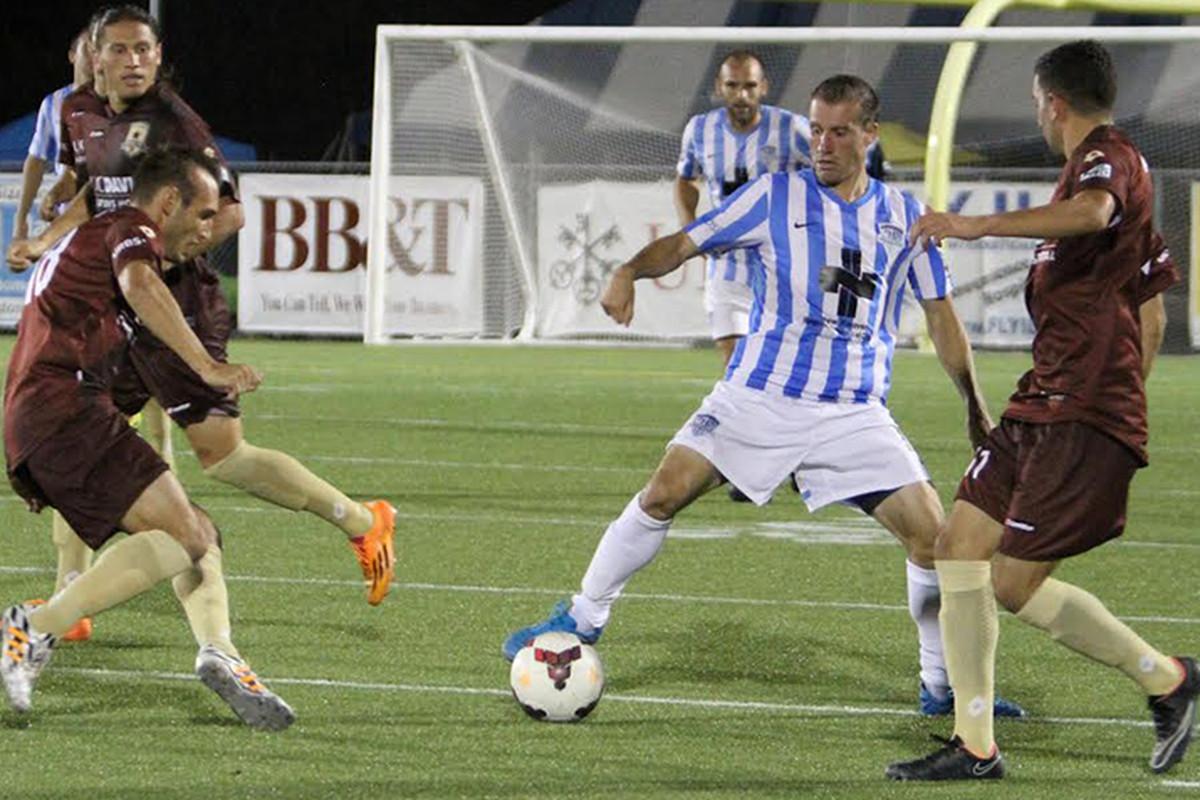 Corben Bone of the Wilmington Hammerheads controls the ball.