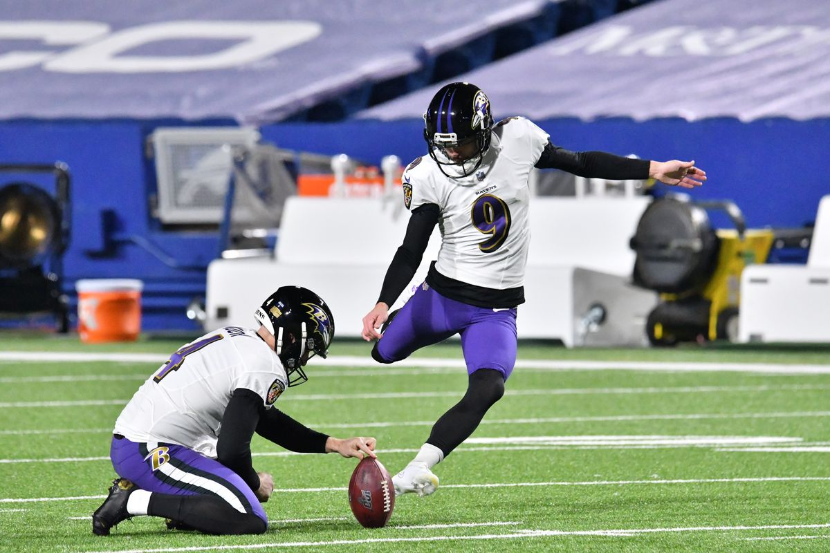 Baltimore Ravens kicker Justin Tucker (9) practices field goals with punter Sam Koch (4) as his holder before a divisional round playoff game against the Buffalo Bills at Bills Stadium.