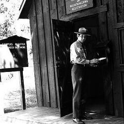 Rick Reese, decked out in his official Jenny Lake climbing ranger uniform, stands outside the Jenny Lake ranger station in 1969.