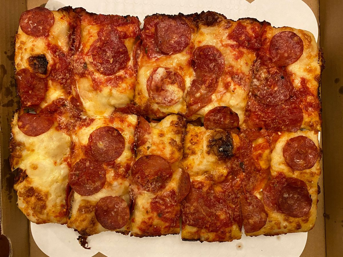 Thick Detroit-style pepperoni pizza from Carbona Pizza inside its box