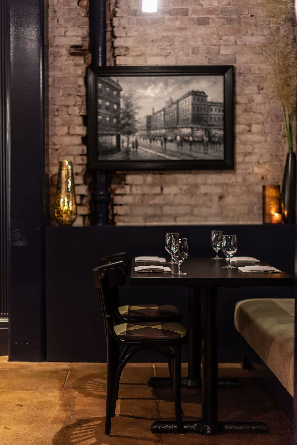 A black and white photo and bistro chairs in a nice room.