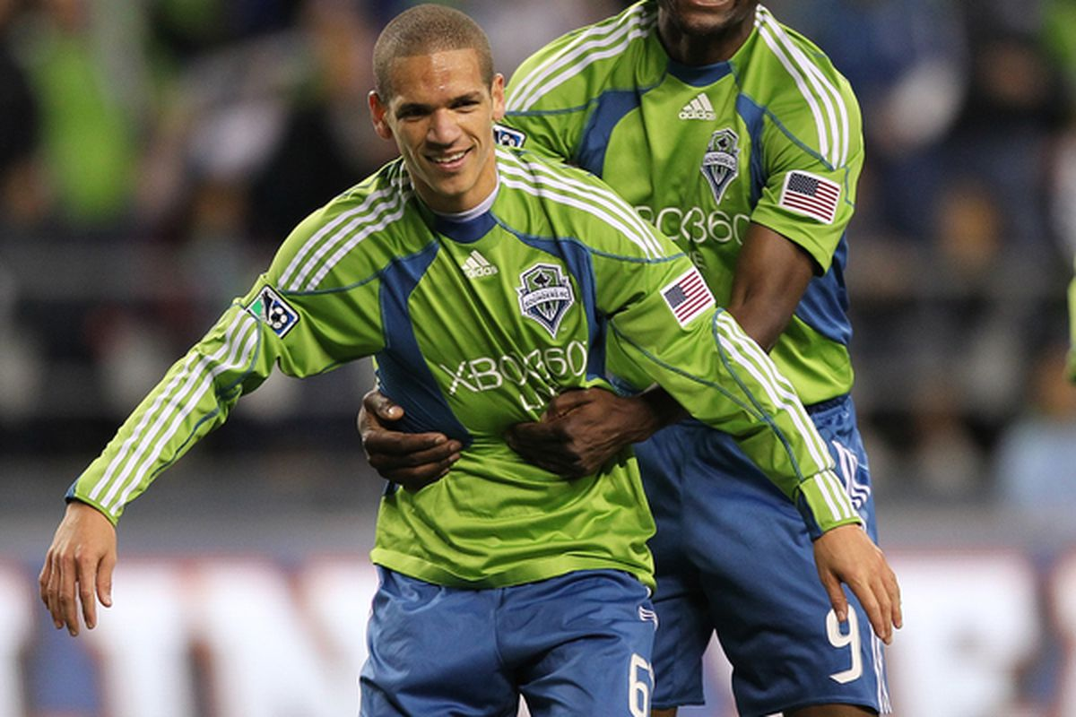 SEATTLE - OCTOBER 15:  Osvaldo Alonso #6 of the Seattle Sounders FC is hugged by Blaise Nkufo #9 after scoring a goal against Chivas USA on October 15 2010 at Qwest Field in Seattle Washington. (Photo by Otto Greule Jr/Getty Images)