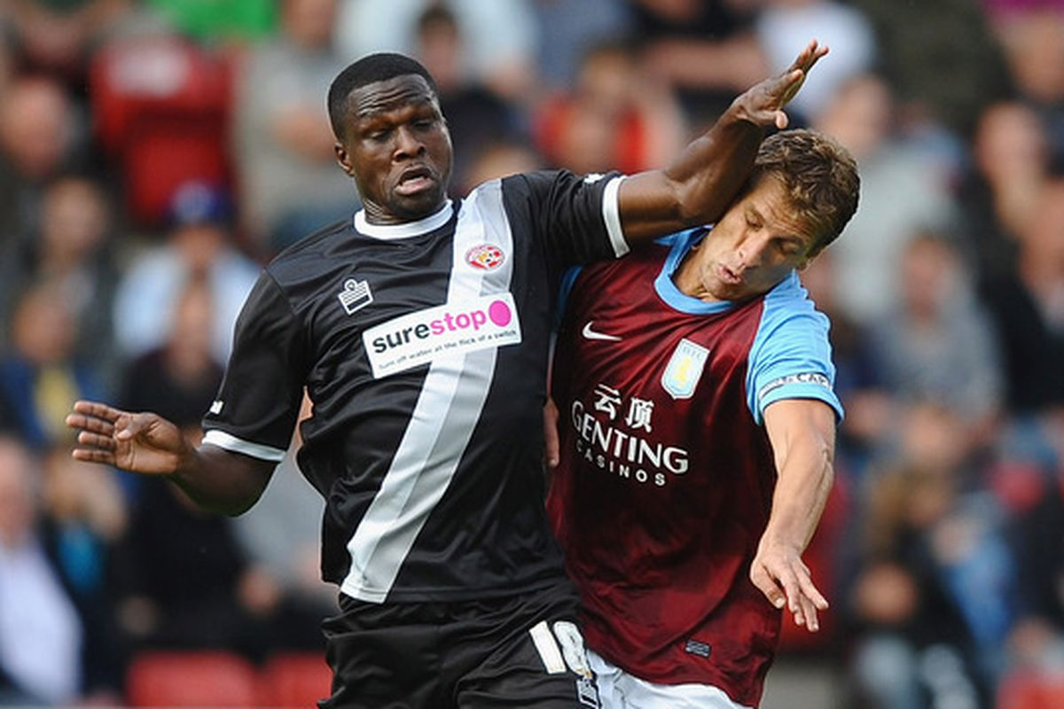 Stiliyan Petrov battles with Claude Gnakpa during a 2011 friendly at the Bank's Stadium between Walsall and Aston Villa.