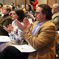 Members of the audience applaud as the Utah Citizens' Counsel announces its 2014 Assessment of Utah's Policy Progress in Salt Lake City, Wednesday, Dec. 10, 2014.