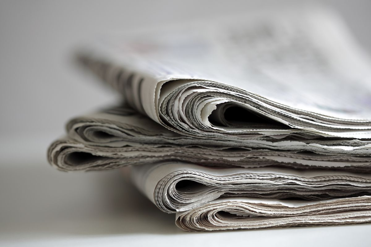 Here is a stock photo of some newspapers, a medium with a thriving future ahead of it.