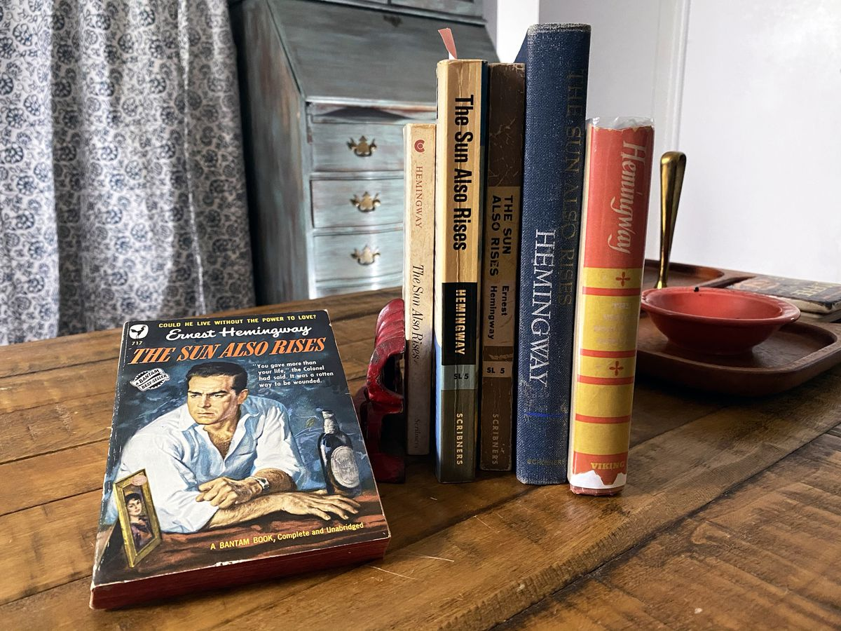Several editions of Ernest Hemingway's The Sun Also Rises