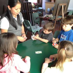Teachers used games like Skipbo to reinforce learning. Here the four oldest children practice their numbers in Spanish.