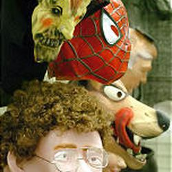 A selection of masks available at the new party and holiday supply store is displayed on the wall.