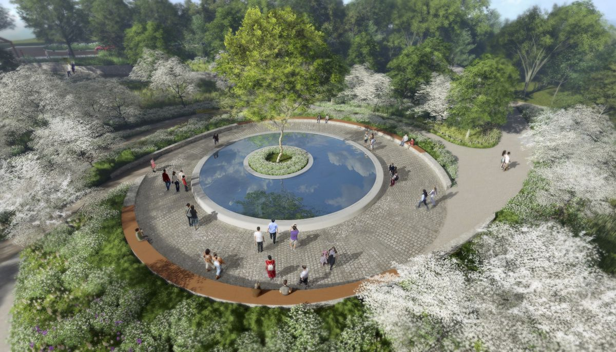 An aerial rendering of the Sandy Hook Memorial, which features a reflecting pool with a tree planted in the center and circular walking paths leading toward the pool