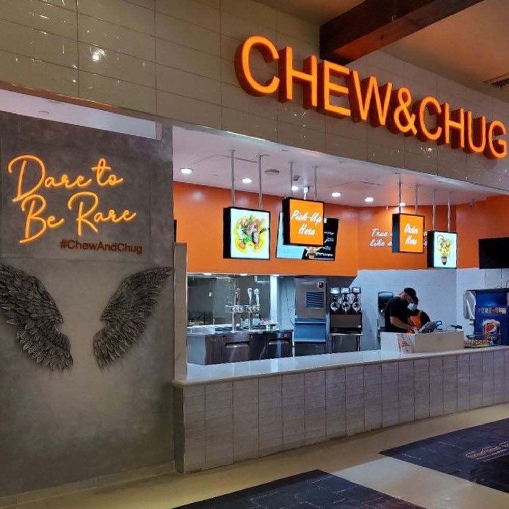 The counter and selfie wall at Chew & Chug in the Venetian's Grand Canal Shoppes food court.