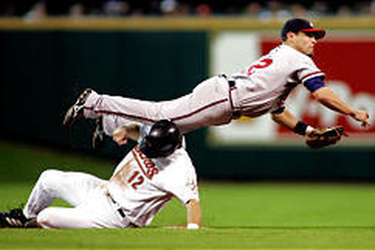 Atlanta's Marcus Giles goes airborne over Houston's Jeff Kent.