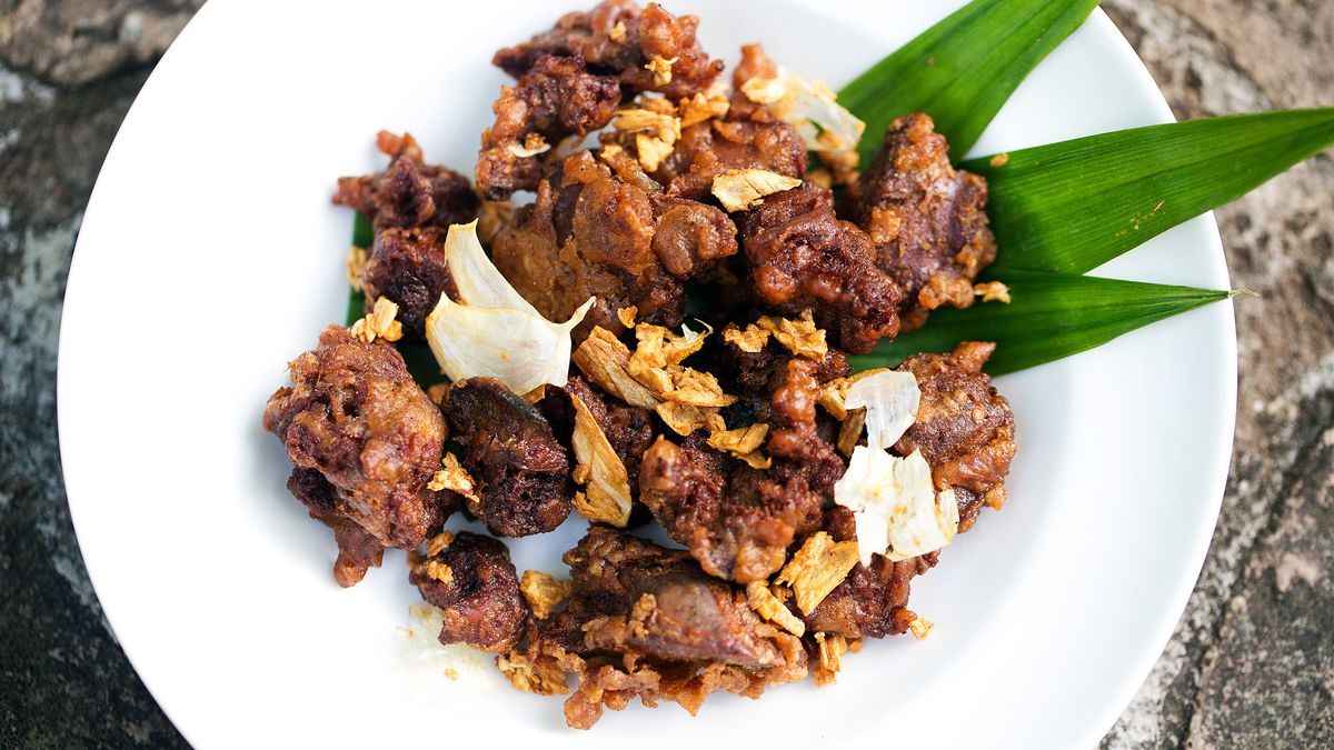 A plate of crispy fried chicken gizzards tossed with garlic