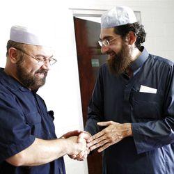 Mohammed Nawaz, left, talks to Muhammed S. Mehtar, the Immam, at the Khadeeja Islamic Center in West Valley City on Friday, June 29, 2012.