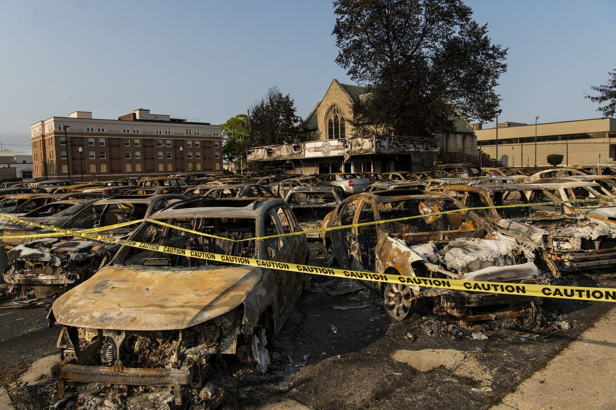 Dozens of burned out cars sit in Car Source Used Pre-owned vehicles at 5821 Sheridan Rd. in Kenosha, Tuesday, Aug. 25, 2020. These vehicles were burned during a protests after police shot Jacob Blake.