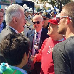 President Dieter F. Uchtdorf, second counselor to the First Presidency of the Church of Jesus Christ of Latter-day Saints, talks to Wisconsin fans on Saturday, Sept. 16, 2016, in Provo.