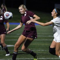 Morgan's Brooklyn Peterson races to the ball past Judge's Bridget Hankins in the 3A high school soccer semifinals at Juan Diego High School in Draper on Wednesday, Oct. 21, 2020.