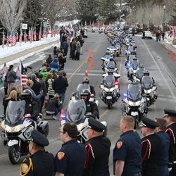 The funeral procession of Unified police officer Doug Barney makes its way to the the Orem City Cemetery on Monday, Jan. 25, 2016. Barney was killed in the line of duty on Jan. 17, 2