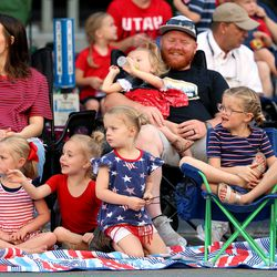 Spectators watch the Days of '47 Parade in Salt Lake City on Friday, July 23, 2021.