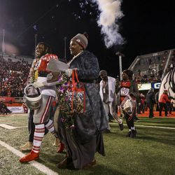 Utah Utes running back Zack Moss (2) walks out with family during senior night festivities before the start of an NCAA football game between the Utah Utes and Colorado Buffaloes at Rice-Eccles Stadium in Salt Lake City on Saturday, Nov. 30, 2019.