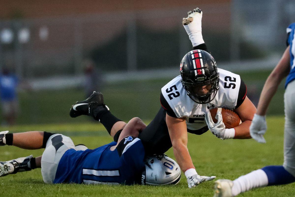 Stansbury's Bridger Thomas stops a run in a high school football game.