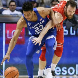Brigham Young Cougars forward Yoeli Childs (23) and Utah Utes forward David Collette (13) vie for a loose ball at the Marriott Center in Provo on Saturday, Dec. 16, 2017.