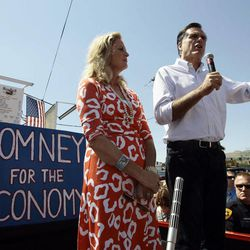 Republican presidential hopeful, Mitt Romney and his wife, Ann, talk to their supports from the back of a pickup truck during a campaign stop at the Hires Big H on 700 East and 400 South in Salt Lake City Friday, June 24, 2011.