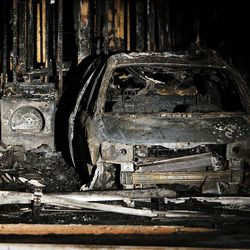 Charred walls abd a burned automobile show at the home of Josh Powell in Puyallup, Washington, Sunday, Feb. 5, 2012.