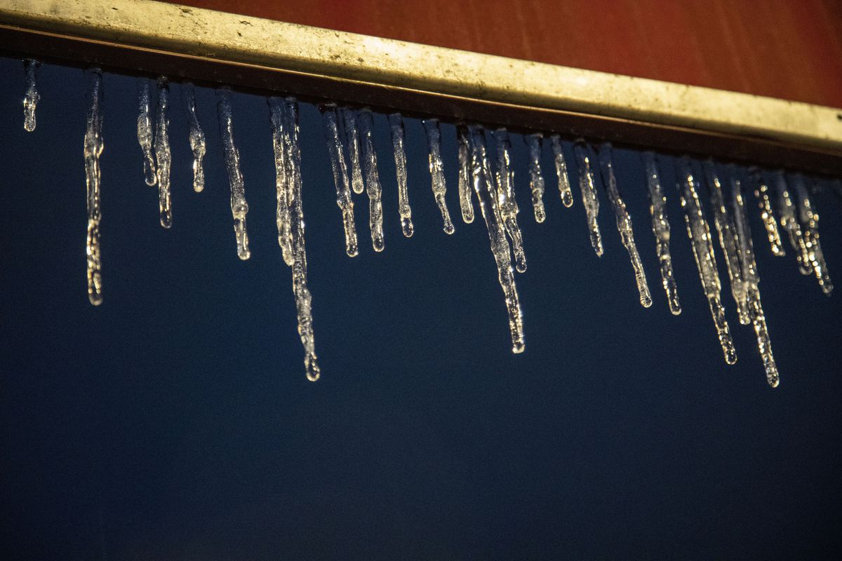 Icicles form on the awning of Jackie-Os in Athens. A...