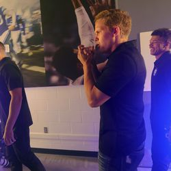 BYU quarterbacks Baylor Romney, left, Jacob Conover and Jaren Hall walk through a hall with a fog machine for photos during BYU football media day at the BYU Broadcasting Building in Provo on Thursday, June 17, 2021.