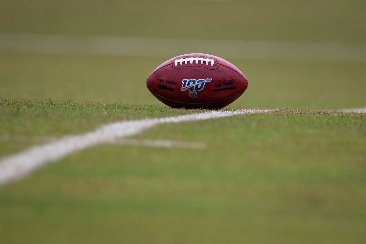 A general view of an NFL ball on the field during a Washington Football Team OTA at Inova Sports Performance Center.